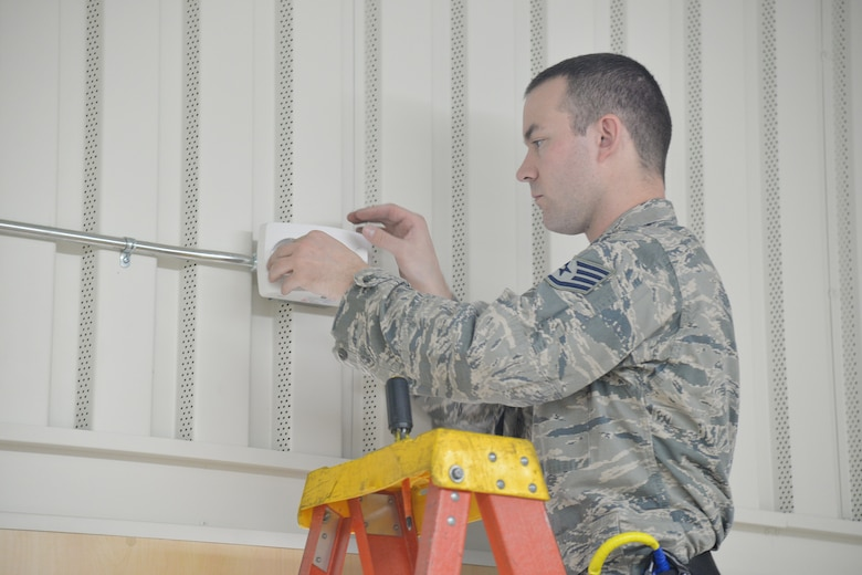 Staff Sgt. Joseph Gessert, 341st Civil Engineer Squadron electrical systems craftsmen, replaces emergency lights in the fitness center March 13, 2017, at Malmstrom Air Force Base, Mont. LED lights require half the wattage of currently used lights and also have a lamp life of 50,000 hours, nearly five times the life of fluorescent lights. (U.S. Air Force photo/Airman 1st Class Daniel Brosam)