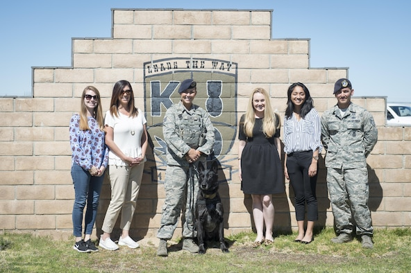 From left: Congressional staffers Alexandria Walker and Cynthia Barile; Staff Sgt. Grace Daniels with Rolf, 412th Security Forces Squadron; staffers Alison Martin and Narah Jayasekera; and Staff Sgt. James Ramsey, 412th SFS; pose for a photo at the 412th SFS Military Working Dog Section March 13. (U.S. Air Force photo by Kyle Larson)