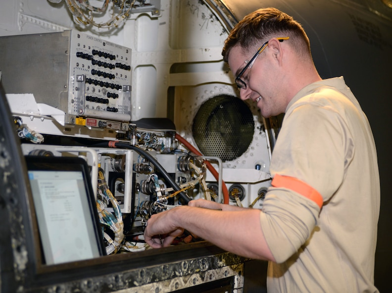 Airman 1st Class David Betchley, an aircraft electrical and environmental systems journeyman assigned to the 28th Maintenance Squadron, changes a volt amp sensor on a B-1 bomber at Ellsworth Air Force Base, S.D., March 8, 2017. After every 800 flight hours, Ellsworth's bombers are sent to hangar 73 to receive an in-depth inspection process that lasts over the course of 20 days. (U.S. Air Force photo by Airman 1st Class Denise M. Jenson)