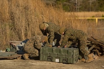 Marines pack up building supplies at Engineer Training Area 7 on Camp Lejeune, N.C., March 15, 2017. The Marines are undergoing basic demolitions training to increase proficiency and confidence with the employment of basic and expedient demolition charges. The Marines are with Combat Logistics Battalion 22, Headquarters Regiment. (U.S. Marine Corps photo by Pfc. Abrey Liggins)