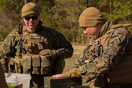 Marines prepare an expedient claymore at Engineer Training Area 7 on Camp Lejeune, N.C., March 15, 2017. The Marines are undergoing basic demolitions training to increase proficiency and confidence with the employment of basic and expedient demolition charges. The Marines are with Combat Logistics Battalion 22, Headquarters Regiment. (U.S. Marine Corps photo by Pfc. Abrey Liggins)