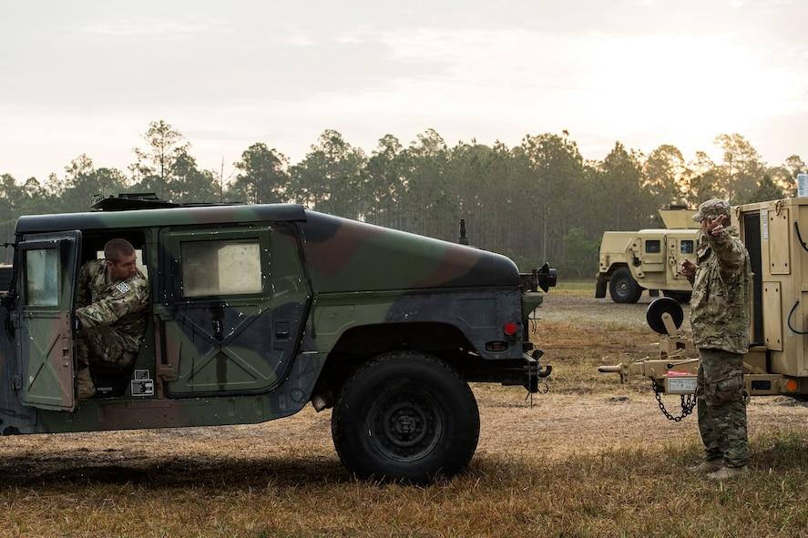 Staff Sgt. Joel Kirtley, 822d Base Defense Squadron NCO in charge of vehicular equipment, backs up a Humvee before connecting it to a generator for transport after a Mission Readiness Exercise, March 13, 2017, at Avon Park Air Force Range, Fla. Throughout the exercise, various missions and scenarios tested the 822d BDS's ability to adapt and overcome as a team and working vehicles were critical to those missions. (U.S. Air Force photo by Airman 1st Class Janiqua P. Robinson)