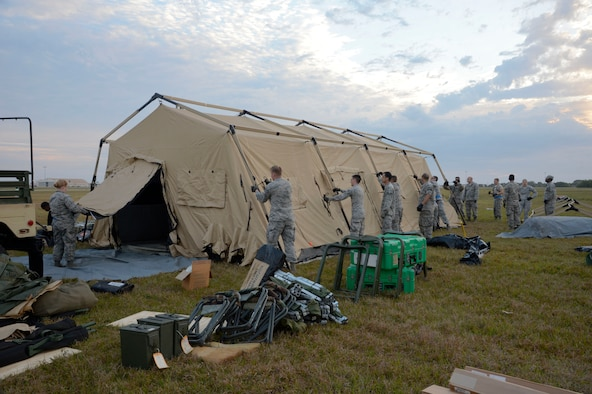 Airmen from the 6th Medical Group build a tent during an aeromedical evacuation exercise at MacDill Air Force Base, Fla., March 12, 2017. The exercise compiled knowledge and hands-on training of site acquirement, set up, patient movement, care and staging. (U.S. Air Force photo by Senior Airman Tori Schultz)