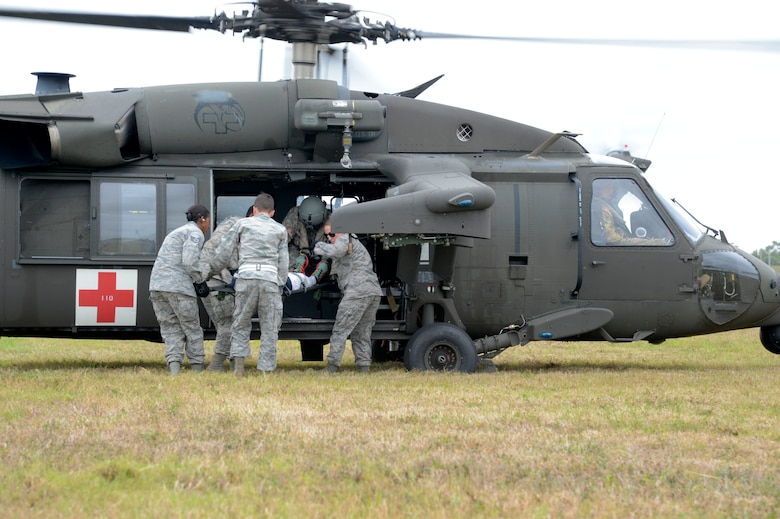 Airmen from the 6th Medical Group practice transporting a patient in a HH-60 Black Hawk helicopter during an aeromedical evacuation exercise at MacDill Air Force Base, Fla., March 12, 2017. Airmen learned how to properly carry and secure a patient and provide patient care in a deployed environment. (U.S. Air Force photo by Senior Airman Tori Schultz)