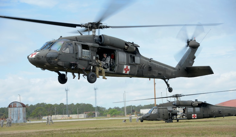 A UH-60 Pave Hawk helicopter begins to take off during an aeromedical evacuation exercise at MacDill Air Force Base, Fla., March 12, 2017. Airmen from the 6th Medical Group had the opportunity to fly in the HH-60 Black Hawk to experience the space and requirements needed for a safe and effective aeromedical evacuation. (U.S. Air Force photo by Senior Airman Tori Schultz)