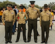 (From left to right) U.S. Marine Corps Brig. Gen. Austin Renforth, commanding general of Marine Corps Recruit Depot Parris Island/Eastern Recruiting Region, Pfc. Madeline Kreamer, Sgt. Maj. Howard Kreamer, the sergeant major of 2nd Marine Aircraft Wing, and Sgt. Maj. Rafael Rodriguez, Marine Corps Recruit Depot Parris Island/Eastern Recruiting Region Sergeant Major, pose for a photo after a graduation ceremony on Marine Corps Recruit Depot, Parris Island, S.C., March 10, 2017. The ceremony is conducted to honor the new Marines. (U.S. Marine Corps photo by Lance Cpl. Colby Cooper/released)