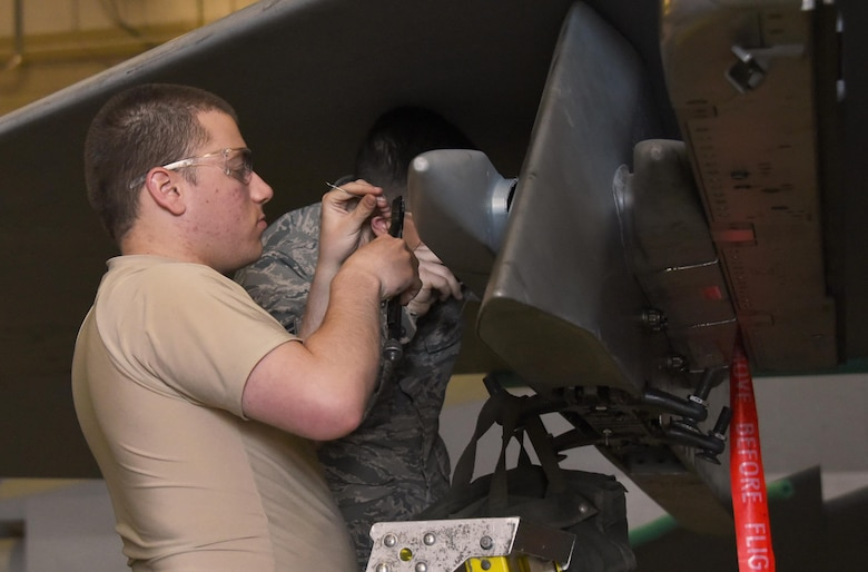 Airman 1st Class Joseph Limoli, 363rd Training Squadron F-15 Eagle armament student, safety wires the bolts on an ADU-552 missile launcher adapter. The wire is an extra safety measure that ensures the bolt doesn't loosen up and fall out in flight. (U.S. Air Force photo by Liz H. Colunga/Released)