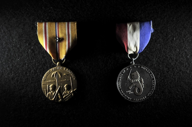 The Asian Pacific Campaign Medal and American Defenders of Bataan and Corregidor Medal awarded to retired Master Sgt. Francis M. Bania after being released as a Prisoner of War of the Bataan Death March. (U.S. Air Force illustration/Staff Sgt. Alexandre Montes)