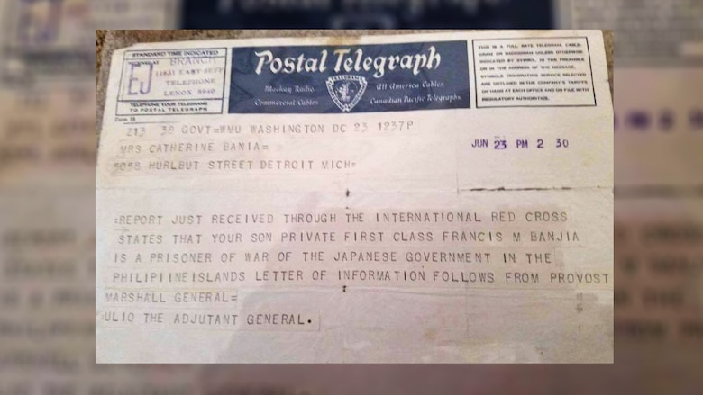 A telegram that was sent to Private First Class Francis M. Bania's wife, Catherine Bania, notifying her that he was a Prisoner of War in 1942. (U.S. Air Force illustration/Staff Sgt. Alexandre Montes)