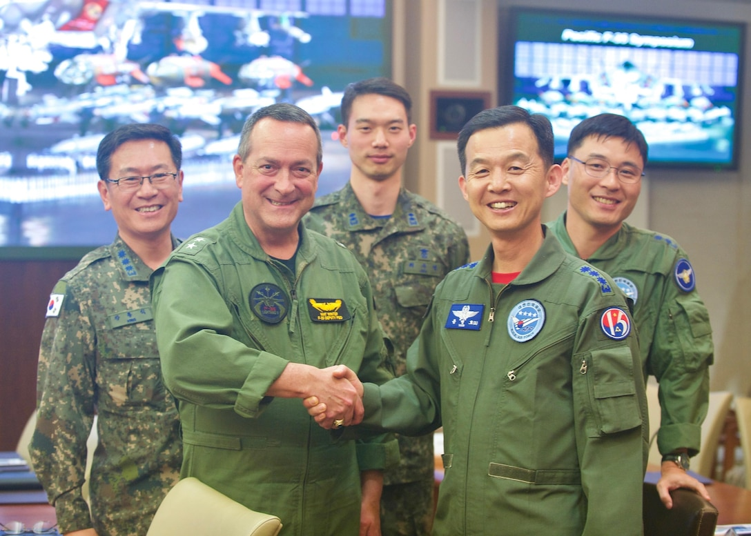 Republic of Korea Air Force Brig. Gen. Yoon Byung Ho (left), ROKAF Headquarters Office of Policy chief, greets U.S. Navy Rear Adm. Mathias Winter, F-35 Lightning II Joint Progam Office deputy program executive officer, during the Pacific F-35 Symposium at Joint Base Pearl Harbor-Hickam, Hawaii, March 15, 2017. The symposium is a Pacific Air Forces-hosted event that brings together the four Pacific members of the F-35 program: Japan, Australia, the Republic of Korea and the U.S. While attending the event, senior officers, warfighters and F-35 experts discussed a range of topics related to integrating the F-35 into multilateral air operations in the Indo-Asia-Pacific. The U.S. currently flies the F-35B out of Marine Corps Air Station Iwakuni, Japan, and is scheduled to field two additional squadrons at Eielson AFB, Alaska, starting in 2020. Australia and Japan are already flying their own F-35s and the ROK is projected to receive its first in 2018. (U.S. Air Force photo by Tech. Sgt. James Stewart)
