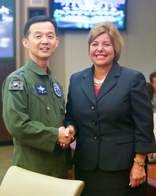 Republic of Korea Air Force Brig. Gen. Yoon Byung Ho (left), ROKAF Headquarters Office of Policy chief, greets Ms. Hiedi H. Grant (right), Deputy Under Secretary of the Air Force, International Affairs, during the Pacific F-35 Symposium at Joint Base Pearl Harbor-Hickam, Hawaii, March 15, 2017. The symposium is a Pacific Air Forces-hosted event that brings together the four Pacific members of the F-35 program: Japan, Australia, the Republic of Korea and the U.S. While attending the event, senior officers, warfighters and F-35 experts discussed a range of topics related to integrating the F-35 into multilateral air operations in the Indo-Asia-Pacific. The U.S. currently flies the F-35B out of Marine Corps Air Station Iwakuni, Japan, and is scheduled to field two additional squadrons at Eielson AFB, Alaska, starting in 2020. Australia and Japan are already flying their own F-35s and the ROK is projected to receive its first in 2018. (U.S. Air Force photo by Tech. Sgt. James Stewart)