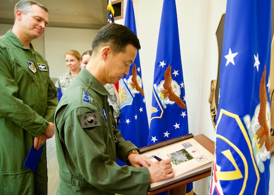Republic of Korea Air Force Brig. Gen. Yoon Byung Ho, ROKAF Headquarters Office of Policy chief, signs Pacific Air Forces' guest book during the Pacific F-35 Symposium at Joint Base Pearl Harbor-Hickam, Hawaii, March 15, 2017. The symposium is a PACAF-hosted event that brings together the four Pacific members of the F-35 program: Japan, Australia, the Republic of Korea and the U.S. While attending the event, senior officers, warfighters and F-35 experts discussed a range of topics related to integrating the F-35 into multilateral air operations in the Indo-Asia-Pacific. The U.S. currently flies the F-35B out of Marine Corps Air Station Iwakuni, Japan, and is scheduled to field two additional squadrons at Eielson AFB, Alaska, starting in 2020. Australia and Japan are already flying their own F-35s and the ROK is projected to receive its first in 2018. (U.S. Air Force photo by Tech. Sgt. James Stewart)