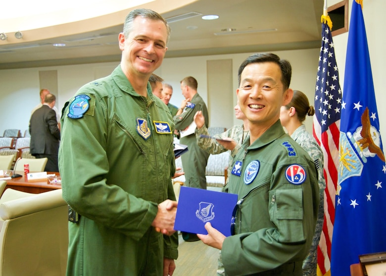 Republic of Korea Air Force Brig. Gen. Yoon Byung Ho (right), ROKAF Headquarters Office of Policy chief, shakes hands with U.S. Air Force Brig. Gen. Craig Wills (left), Pacific Air Forces Strategy, Plans and Programs director, during the Pacific F-35 Symposium at Joint Base Pearl Harbor-Hickam, Hawaii, March 15, 2017. The symposium is a PACAF-hosted event that brings together the four Pacific members of the F-35 program: Japan, Australia, the Republic of Korea and the U.S. While attending the event, senior officers, warfighters and F-35 experts discussed a range of topics related to integrating the F-35 into multilateral air operations in the Indo-Asia-Pacific. The U.S. currently flies the F-35B out of Marine Corps Air Station Iwakuni, Japan, and is scheduled to field two additional squadrons at Eielson AFB, Alaska, starting in 2020. Australia and Japan are already flying their own F-35s and the ROK is projected to receive its first in 2018. (U.S. Air Force photo by Tech. Sgt. James Stewart)