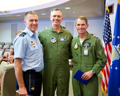 Royal Australian Air Force Air Commodores Terry Saunder (left) and Robert Chipman (right) pose for a group photo with U.S. Air Force Brig. Gen. Craig Wills (center), Pacific Air Forces Strategy, Plans and Programs director, during the Pacific F-35 Symposium at Joint Base Pearl Harbor-Hickam, Hawaii, March 15, 2017. The symposium is a PACAF-hosted event that brings together the four Pacific members of the F-35 program: Japan, Australia, the Republic of Korea and the U.S. While attending the event, senior officers, warfighters and F-35 experts discussed a range of topics related to integrating the F-35 into multilateral air operations in the Indo-Asia-Pacific. The U.S. currently flies the F-35B out of Marine Corps Air Station Iwakuni, Japan, and is scheduled to field two additional squadrons at Eielson AFB, Alaska, starting in 2020. Australia and Japan are already flying their own F-35s and the ROK is projected to receive its first in 2018. (U.S. Air Force photo by Tech. Sgt. James Stewart)