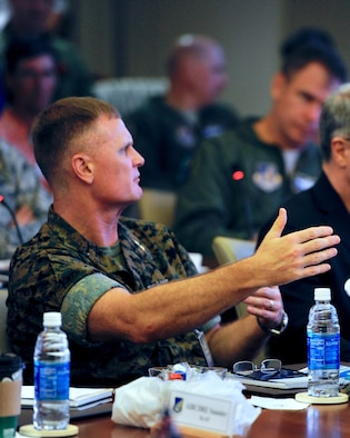 U.S. Marine Corps Maj. Gen. Steven Rudder, U.S. Pacific Command's Strategic Planning director, speaks with a Subject Matter Expert panel about F-35 Lightning II deployment operations during the Pacific F-35 Symposium at Joint Base Pearl Harbor-Hickam, Hawaii, March 15, 2017. The symposium is a Pacific Air Forces-hosted event that brings together the four Pacific members of the F-35 program: Japan, Australia, the Republic of Korea and the U.S. While attending the event, senior officers, warfighters and F-35 experts discussed a range of topics related to integrating the F-35 into multilateral air operations in the Indo-Asia-Pacific. The U.S. currently flies the F-35B out of Marine Corps Air Station Iwakuni, Japan, and is scheduled to field two additional squadrons at Eielson AFB, Alaska, starting in 2020. Australia and Japan are already flying their own F-35s and the ROK is projected to receive its first in 2018. (U.S. Air Force photo by Master Sgt. George Maddon)