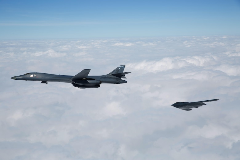 A B-1B Lancer and B-2 Spirit fly near Barksdale Air Force Base, La., Feb. 2, 2017. The two bombers, along with a B-52 Stratofortress, flew an in-trail formation over Barksdale AFB during a retreat ceremony held by the Eighth Air Force. Distinguished guests, leadership and 'Mighty Eighth' Airmen gathered to celebrate the Eighth Air Force's 75th anniversary by partaking in various events throughout the week. Eighth Air Force dates back to VIII Bomber Command and World War II, which came into being Feb. 1, 1942.  (U.S. Air Force courtesy photo by Sagar Pathak)
