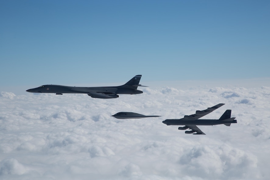 A three-ship bomber formation composed of a B-1B Lancer, B-2 Spirit and B-52 Stratofortress fly near Barksdale Air Force Base, La., Feb. 2, 2017. The bombers participated in an in-trail formation flyover to honor and commemorate the Eighth Air Force's 75th anniversary. (U.S. Air Force courtesy photo by Sagar Pathak)
