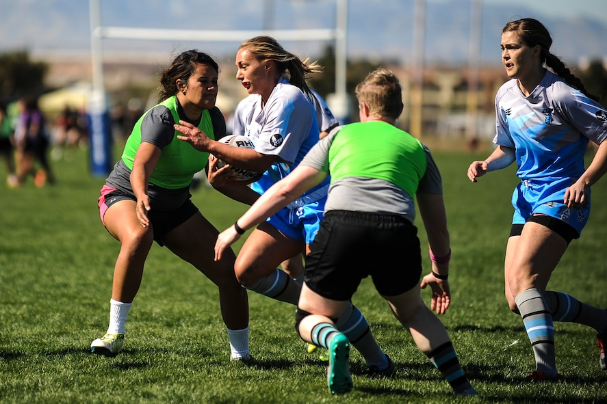 Leanne Hardin, a wing on the Air Force women's rugby sevens team, runs with the ball during a Las Vegas Invitational match in Las Vegas, March 2, 2017. Hardin, a staff sergeant stationed at Pápa Air Base, Hungary, played multiple sports growing up and was encouraged by a coworker who played on the men's team to give rugby a try. (U.S. Air Force photo by Staff Sgt. Siuta B. Ika)