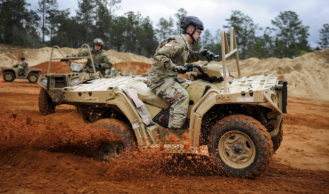 A Soldier with the 1st Battalion, 10th Special Forces Group, executes a sharp turn in an all-terrain vehicle at Buck Pond in Navarre, Fla., March 14, 2017. An instructor with the 1st Special Operations Support Squadron Operational Support Joint Office trained Soldiers on riding techniques to qualify them for ATV usage in special operations missions. (U.S. Air Force photo by Airman 1st Class Dennis Spain)