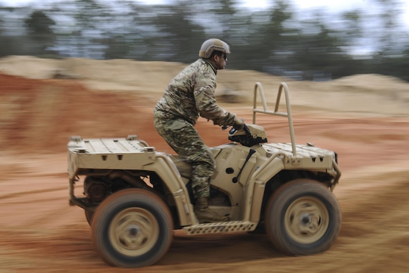 A Soldier with the 1st Battalion, 10th Special Forces Group, rides an all-terrain vehicle at Buck Pond in Navarre, Fla., March 14, 2017. An instructor from the 1st Special Operations Support Squadron Operational Support Joint Office taught Soldiers ATV techniques such as weight placement during a turn, how to stop properly and how to safely climb a hill. (U.S. Air Force photo by Airman 1st Class Dennis Spain)