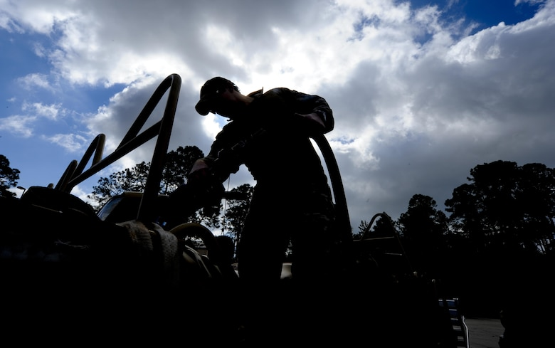 A Solider with 1st Battalion, 10th Special Forces Group, refuels the gas tank of an all-terrain vehicle at Buck Pond in Navarre, Fla., March 14, 2017. An instructor from the 1st Special Operations Support Squadron Operational Support Joint Office taught Soldiers riding techniques to qualify them for ATV usage in special operations missions. (U.S. Air Force photo by Airman 1st Class Dennis Spain)