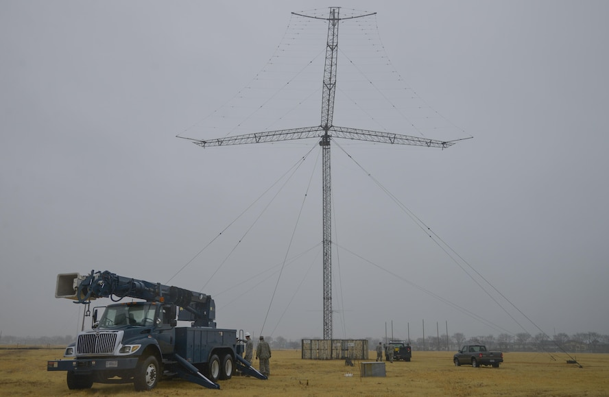 Members of the 374th Communication Squadron Cable and Antenna System Unit set up their trucks prior to taking down a rotatable log periodic antenna at the Tokorozawa Communication Site, Japan, March 14, 2017. Removing the antenna will allow a road to be placed through the site for emergency vehicles to have a quicker response time. (U.S. Air Force photo by Staff Sgt. David Owsianka)