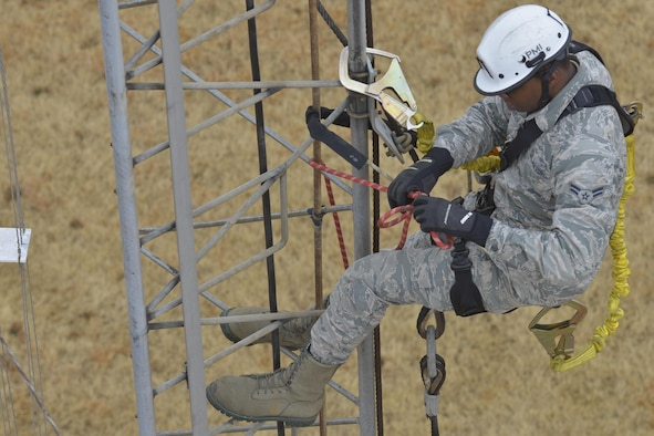 Airman 1st Class Darren Perry, 374th Communication Squadron cable and antenna system technician, ties a rope on a rotatable log periodic antenna at the Tokorozawa Communication Site, Japan, March 14, 2017. The antennas at Tokorozawa provide communication support to a variety of Department of Defense installations throughout the Pacific. (U.S. Air Force photo by Staff Sgt. David Owsianka)