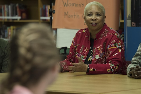 Mrs. Charlotte Parris, 374th Medical Support Squadron appointment clerk, answers questions from students at Yokota High School during the Q-and-A panel held as part of the Women's History Month at Yokota Air Base, Japan, March 15, 2017. During a Q-and-A panel on how women have blazed trails in labor and business, Parris discussed her experiences as a former Naval Criminal Investigative Service member. (U.S. Air Force photo by Machiko Arita)