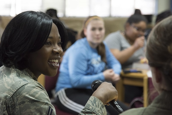 Airman 1st Class Musenge Ludumuna, 374th Surgical Operations Squadron health administrator, answers questions from students at Yokota High School during the Q-and-A panel held as part of the Women's History Month at Yokota Air Base, Japan, March 15, 2017. Six women from Yokota attended as panel speakers. (U.S. Air Force photo by Machiko Arita)