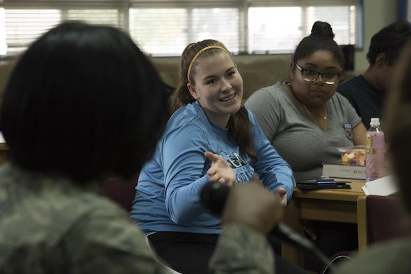 A student from Yokota High School asks a question to panel speakers during the Q-and-A panel held as part of the Women's History Month at Yokota Air Base, Japan, March 15, 2017. Each panel speaker spoke on their jobs and who and what they felt helped pave the way for them to get where they are today. (U.S. Air Force photo by Machiko Arita)