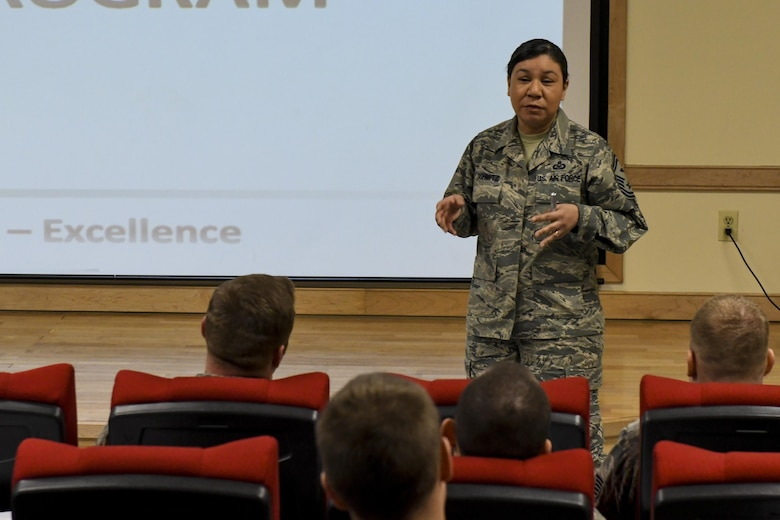 U.S. Air Force Senior Master Sgt. Cynthia Schmitz, 51st Civil Engineer Squadron first sergeant, explains the importance of family care programs during a first sergeant symposium at Osan Air Base, Republic of Korea, March 14, 2017. Schmitz, who has been a first sergeant for more than seven years, was one of many experienced first sergeants and commanders who spoke with the NCOs, senior NCOs and company grade officers attending the symposium. (U.S. Air Force photo by Staff Sgt. Victor J. Caputo)