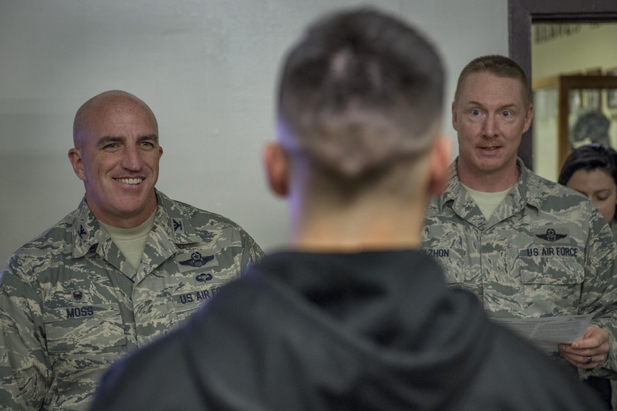 Col. Kenneth Moss, 374th Airlift Wing commander, and Chief Master Sgt. Michael L. Molzhon, 374th Operations Group superintendent, listen to a brief prior to being tased during a 374th Security Forces Squadron less-lethal weapons demonstration March 15, 2017, at Yokota Air Base, Japan. Moss volunteered to be part of the demonstration to experience and understand more of what SFS members go through and to show his support. (U.S. Air Force photo by Airman 1st Class Donald Hudson)