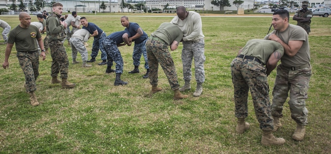 U.S. Military members from U.S. Marine Corps, U.S. Navy, U.S. Air Force, and U.S. Army practice Marine Corps martial arts program techniques as part of the Joint Okinawa Experience, a senior leadership professional military education class, March 16, 2017, on Camp Hansen, Japan. Five days of travelling and learning together gave each member an appreciation of their fellow service member and their component in the joint mission. (U.S. Air Force Photo by Senior Airman Nick Emerick)