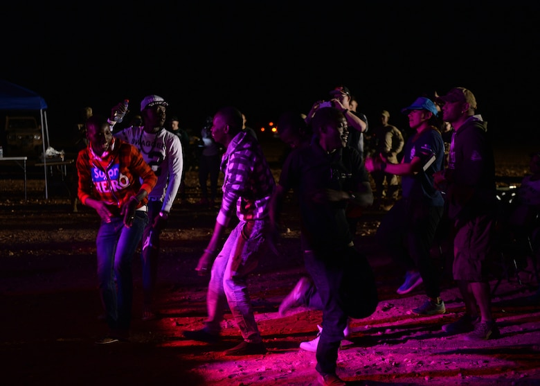 Members of the Forces Armées Nigeriennes dance during an entertainment event at Nigerien Air Base 201, Agadez, Niger, March 10, 2017. An ensemble of the United States Air Forces in Europe Band known as Touch 'n Go performed for Airmen deployed to Niger as well as their counterparts. (U.S. Air Force photo by Senior Airman Jimmie D. Pike)