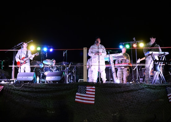 Members of Touch 'n Go, an ensemble of the United States Air Forces in Europe Band, perform for Airmen and members of the Forces Armées Nigeriennes at Nigerien Air Base 201, Agadez, Niger, March 10, 2017. Touch 'n Go performed for Airmen deployed to Niger as well as their counterparts. (U.S. Air Force photo by Senior Airman Jimmie D. Pike)