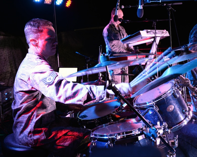 Staff Sgt. Mark Wheeler, United States Air Forces in Europe Band percussionist, plays the drums during a performance at Nigerien Air Base 201 near Agadez, Niger, March 10, 2017. An ensemble of the USAFE Band, known as Touch 'n Go, performed for Airmen deployed to Niger as well as their counterparts in the Forces Armées Nigeriennes. (U.S. Air Force photo by Senior Airman Jimmie D. Pike)