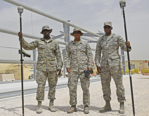 Engineer assistants with the 379th Expeditionary Civil Engineer Squadron GEOBASE section pose for a photo at Al Udeid Air Base, Qatar, March 15, 2017. Airmen with the GEOBASE section survey, map, draft and maintain common installation picture maps and have the ability to produce unit specific maps of Al Udeid AB.  (U.S. Air Force photo by Senior Airman Cynthia A. Innocenti)