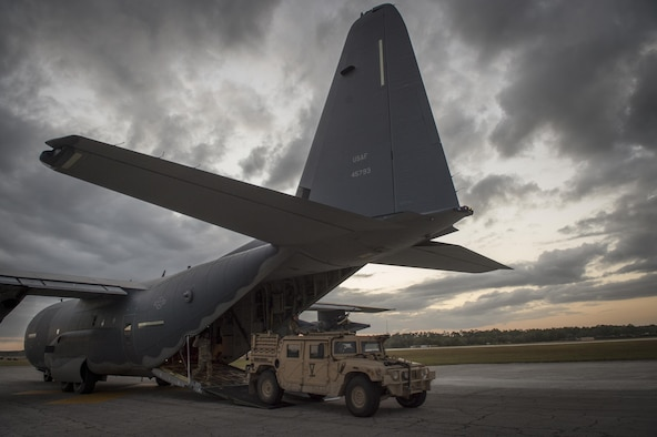 Humvees depart an MC-130J Commando II during Emerald Warrior 17 at Hurlburt Field, Fla., March 6, 2017. Emerald Warrior is a U.S. Special Operations Command exercise during which joint special operations forces train to respond to various threats across the spectrum of conflict. (U.S. Air Force photo/Staff Sgt. Cory D. Payne)