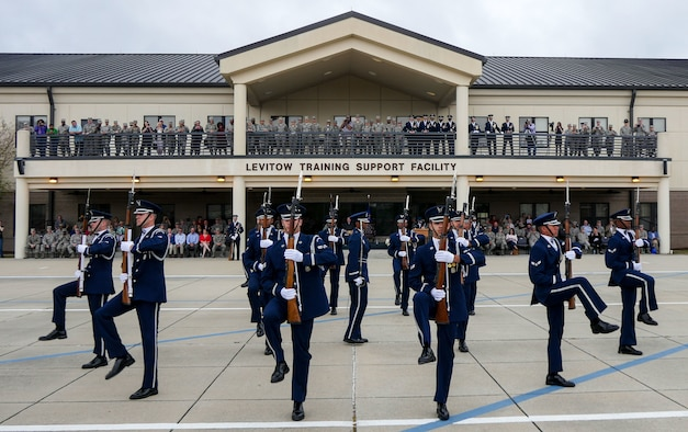 The U.S. Air Force Honor Guard Drill Team debuts their 2017 routine during the 81st Training Group drill down March 10, 2017, on Keesler Air Force Base, Miss. The team travels to Keesler AFB every year for five weeks to develop a new routine that they will use throughout the year. (U.S. Air Force photo/Capt. David J. Murphy)