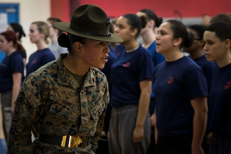 Staff Sgt. Grace Gomez, drill instructor for November Co., 4th Recruit Training Battalion, Marine Corps Recruit Depot Parris Island, South Carolina, speaks to female poolees during the Recruiting Station Portsmouth's Female Pool Function at Hanscom Air Force Base, March 4, 2017. The purpose of the event was to screen the poolees, conduct an Initial Strength Test and give them a period of instruction with a drill instructor prior to them leaving for recruit training.