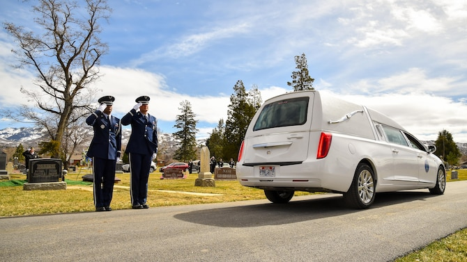 Hill AFB Honor Guard members Airman 1st Class Santos Vargas and Senior Airman James Fahrner render salutes as a hearse arrives during a veteran's funeral service, Bountiful, Utah, March 8, 2017. Hill's honor guard members provide professional military funeral honors for active duty, retired members and veterans. (U.S. Air Force photo/R. Nial Bradshaw)