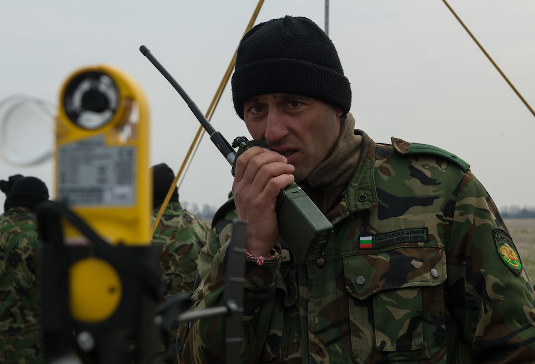 Lt. Col. Bozhider Boykov, Bulgaria's Special Operations 1st Battalion, 86th Brigade commander, communicates wind readings from the drop zone to Bulgarian military pilots during Exercise Thracian Spring 17 at Plovdiv Regional Airport, Bulgaria, March 15, 2017. Boykov worked with a 435th Contingency Response Group drop zone controller throughout the two-week training to execute a safe personnel drop. The combined exercise aims to facilitate overall relations and build Bulgaria's joint military capabilities. (U.S. Air Force photo by Staff Sgt. Nesha Humes)