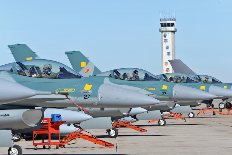 U.S. Air Force pilots assigned as Ferry Cell 5 prepare their Indonesian F-16 Fighting Falcon aircraft prior to departure on March 14 from Hill Air Force Base, Utah.  (U.S. Air Force Photo by Alex R. Lloyd)