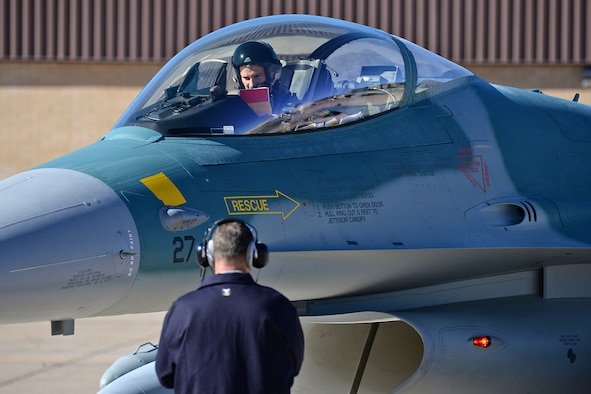 Ferry Cell 5 Flight Lead checks his flight documents prior to departure from Hill Air Force Base, Utah.  (U.S. Air Force Photo by Alex R. Lloyd)