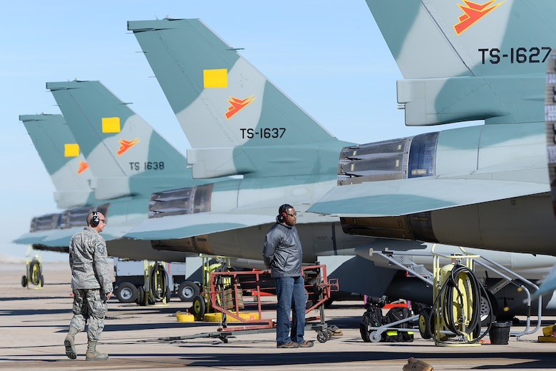 Ground crews walk around the Indonesian F-16 Fighting Falcon aircraft to ensure everthing is looking good prior to departure.  (U.S. Air Force Photo by Alex R. Lloyd)