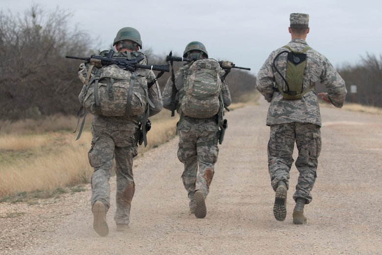 U.S. Air Force Airmen assigned to the 7th Security Forces Squadron march back to the squadron after completing the Top Defender Challenge March, 11, 2017, at Dyess Air Force Base, Texas. The event was designed to determine the best two-man team leading up to Air Force Global Strike Challenge. (U.S. Air Force Photo by Tricia Bruton)