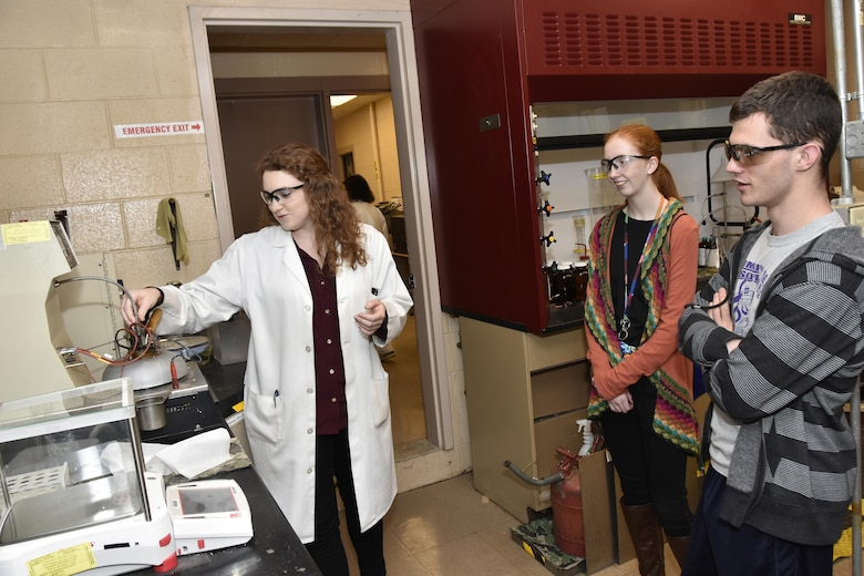 As part of the Engineers Engineer for a Day activities Feb. 22, AEDC analyst Mary Forde, pictured left, explains flash point testing to students interested in Chemical Engineering. Visiting the AEDC Chemistry Laboratory are, pictured at right, Fayetteville High School student Kaytlin Hobbs and Community High School student Brandon Waller. (U.S. Air Force photo/Rick Goodfriend)