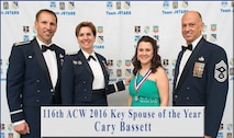 Brandy Seifert, center, accepts a 461st Air Control Wing (ACW) medallion in recognition of winning the 461st ACW Key Spouse of the Year award, from General Lori Robinson, commander of North American Aerospace Defense Command and U.S. Northern Command, while Col. John Cooper, commander of the 461st ACW, and Chief Master Sgt. Jacob Simmons, command chief of the 461st ACW, and her husband look on at the Museum of Aviation, Robins Air Force Base, Ga., Feb. 10, 2017. The Air Force Key Spouse Program is an official Air Force unit family readiness program designed to enhance mission readiness and resiliency and establish a sense of community. The Key Spouse Program promotes individual, family and unit readiness and is vital to building strong Air Force communities. (U.S. Air Force photo illustration by Senior Master Sgt. Roger Parsons)