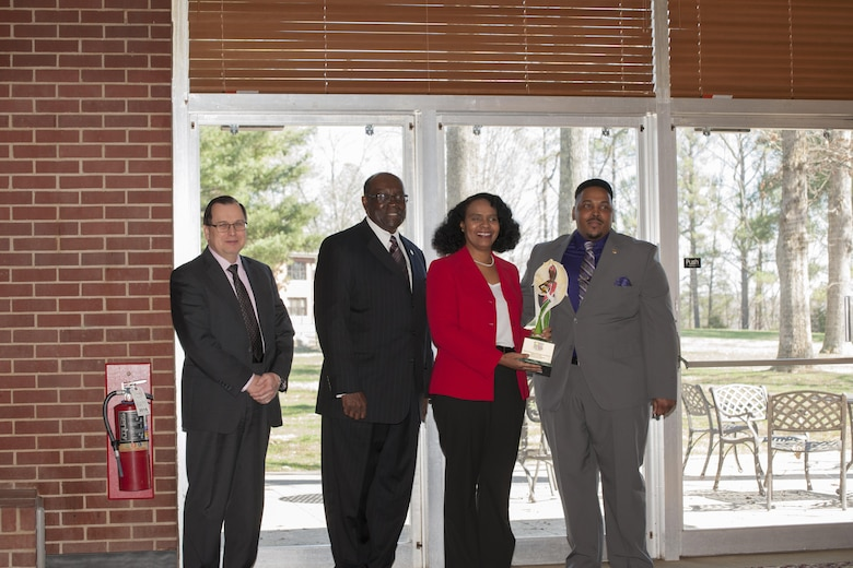 Willie Jo Taylor, second from right, a retiree of AEDC, received the AEDC African American Heritage Committee Achievement of Excellence award at the luncheon Feb. 16 at Arnold Lakeside Center. Taylor was one of the first black females to work at AEDC as part of a stay-in-school program in 1979. She was accompanied at the luncheon by her husband of 37 years, Gregory Taylor, and her daughter, AEDC team member Dana Taylor Henry. Pictured during the award presentation, left to right, are Dr. Mark Mehalic, AEDC executive director; Dr. Andrew Hugine Jr., president of Alabama A&M University; Taylor; and Artious Walker, member of the AEDC African American Heritage Committee. (U.S. Air Force photo/Jacqueline Cowan)