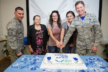 Brig. Gen. Wayne Monteith, 45th Space Wing commander (right), base community members and Chief Master Sgt. Jason Lamoureux, 45th Space Wing command chief, (left), celebrate the 75th anniversary of the Air Force Aid Society during a ceremony March 10, 2017, at Patrick Air Force Base, Fla. The Air Force Aid Society (AFAS) is the official charity of the United States Air Force incorporated in 1942 as a non-profit organization whose mission is to help relieve financial distress of Air Force members and their families and to assist them in financing their higher education goals. (U.S. Air Force photo/Matthew Jurgens)